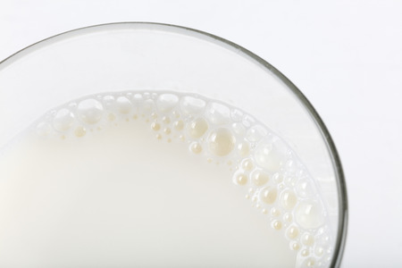 White Milk on glass close up shot. Imagens