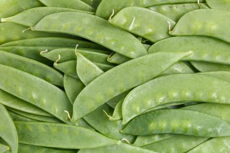 Green fresh snow peas  background close up