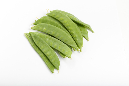 Fresh snow peas isolated on white background