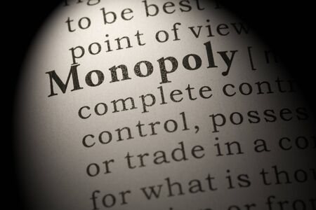 Fake Dictionary, Dictionary definition of word monopoly. Stock Photo