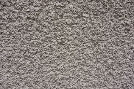 seamless crushed stone in cement, plaster wall texture background Archivio Fotografico