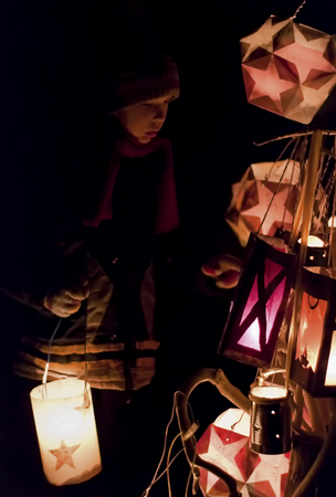 illuminated: boy holding illuminated paper lantern