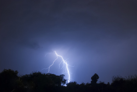 Lightning flash on a thunder storm in the night skies Stock Photo - 46912688
