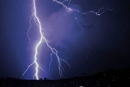 rain weather: Bing Bang lightning strike on the horizon Stock Photo