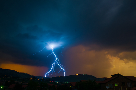 Intervert Y cloud to ground lightning with sun setting behind