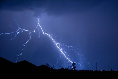 lightning strike: Cloud to Ground forked Lightning Strike Stock Photo