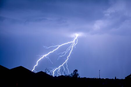 Cloud to Ground forked Lightning Strike Stock Photo
