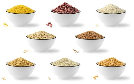 Collection of 8 cereals and legumes in bowls isolated on white background