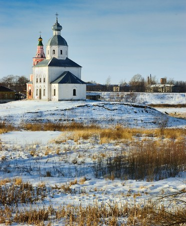 Winter landscape with an orthodox church in Suzdal, Russia photo