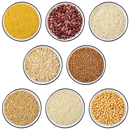 Collection of 8 cereals and legumes in cups isolated on white background. Top view Stock Photo - 7037077