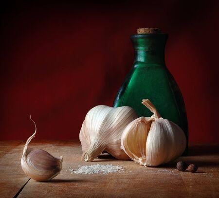 bulbet: Vintage still life with garlic, salt and allspice Stock Photo