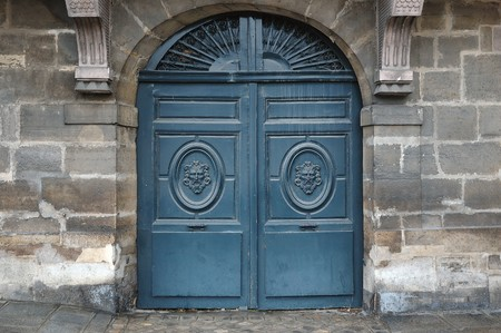 Old wooden door with metal and wooden ornaments photo
