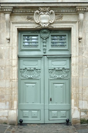 Old wooden door with ornaments photo