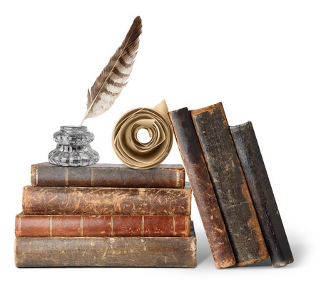 Old books, inkstand and scroll isolated on white photo
