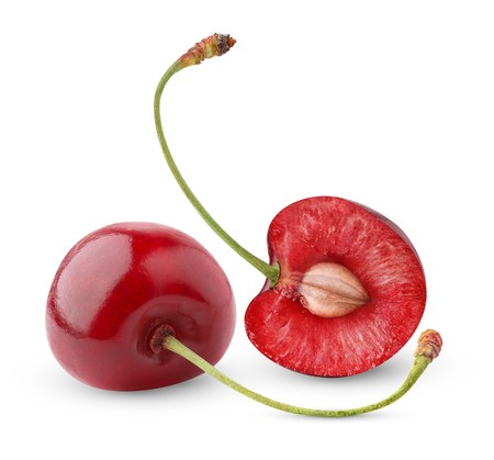 cross cut: Two sweet cherries isolated on white