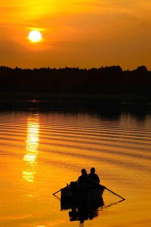 Fishermen in boat at sunset Stock Photo - 7920719