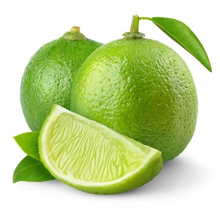 lima limon: Limes frescos aislados en blanco Foto de archivo