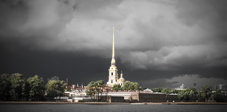 St Petersburg, Russia. Peter and Paul Fortress against dramatic clouds after thunderstorm photo