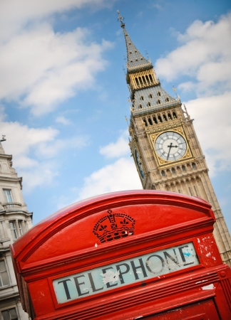 Red telephone booth against Big Ben tower in London, UK