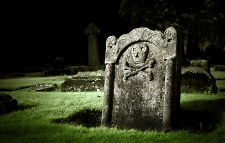 Grafsteen in de oude begraafplaats Stockfoto