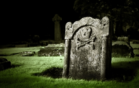 ghostly: Gravestone in old cemetery Stock Photo
