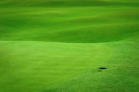 golf green: Detail of golf field with a ball hole Stock Photo