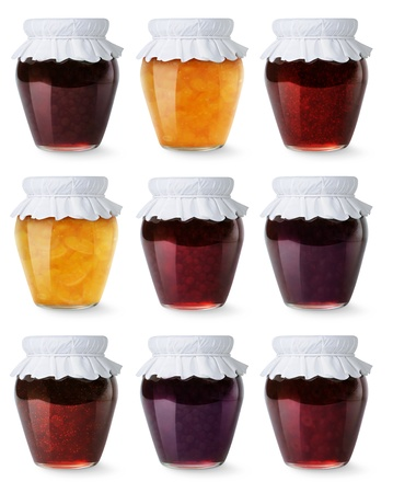Glass jars with homemade jam isolated on white photo