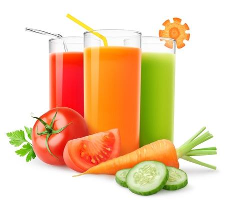 白で隔離される新鮮な野菜ジュース 写真素材