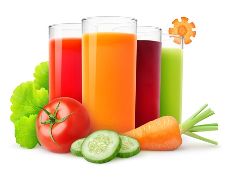 Fresh vegetable juices isolated on white photo