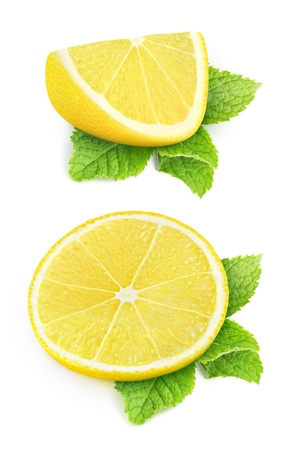 Two pieces of lemon and mint leaves isolated on white