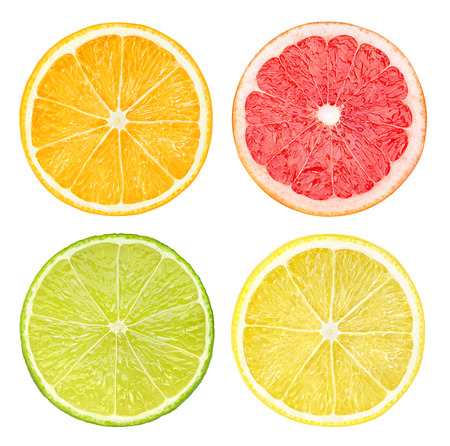 organic lemon: Slices of citrus fruits isolated on white