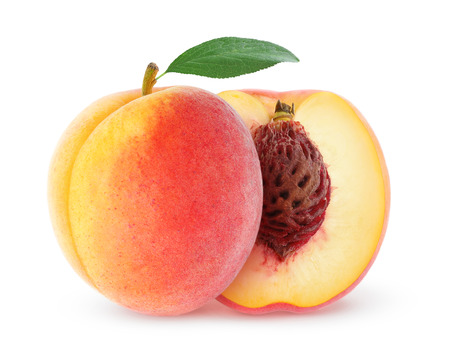 Fresh peach with leaf isolated on white