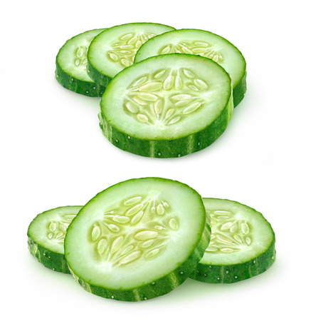 Slices of cucumber over white background