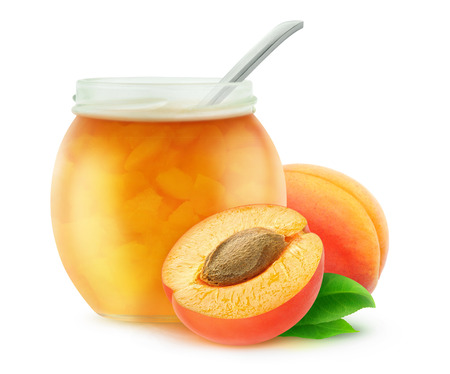 apricot kernel: Apricot jam in a jar with spoon, isolated on white with clipping path