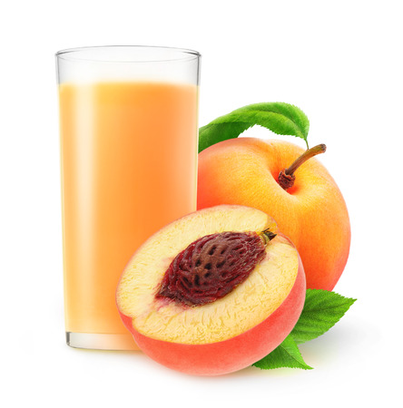 non alcoholic beverage: Peach juice in a glass isolated on white