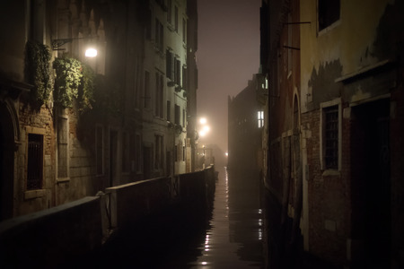 foggy: Small canal in Venice at night