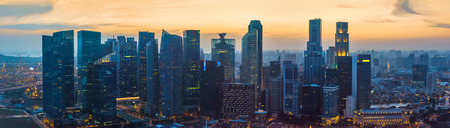 commercial building: Skyscrapers of Singapore downtown at sunset, aerial view
