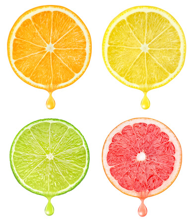 Slices of citrus fruits with drop of juice isolated on white with clipping path Standard-Bild