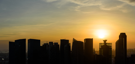 commercial building: Silhouettes of Singapore skyscrapers at sunset