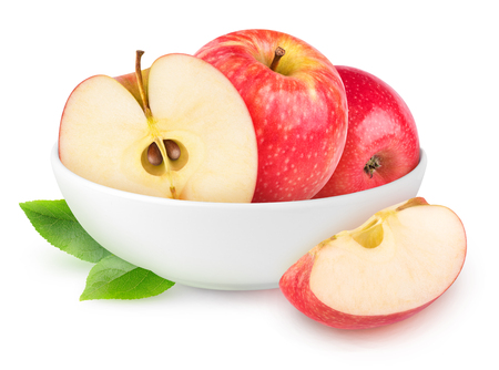 Isolated apples. White bowl with cut apple fruits isolated on white background with clipping path