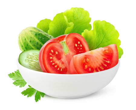 Isolated ?ut vegetables. Fresh cucumber, tomato and lettuce in ceramic bowl isolated on white background Stock Photo
