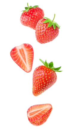 Isolated strawberries. Falling strawberry fruits whole and cut in half isolated on white background with clipping path Stok Fotoğraf - 83421372