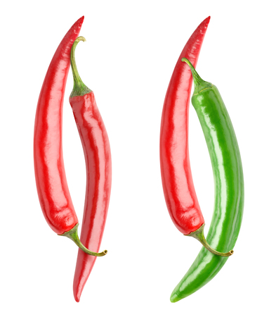 Isolated peppers. Red and green chili peppers crossed like Yin and Yang isolated on white background