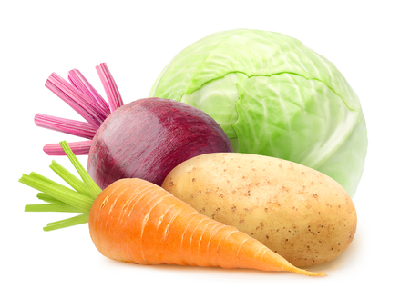 Isolated vegetables. Raw carrot, potato, beetroot and cabbage isolated on white background with clipping path