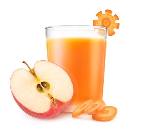 Isolated drink. Pieces of red apple and fresh carrot and glass of fruit juice isolated on white background with clipping path Stock Photo