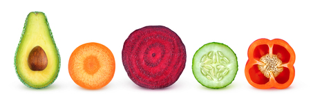 Isolated vegetable slices. Fresh vegetables cut in half (avocado, carrot, beetroot, cucumber, bell pepper) in a row isolated on white background with clipping path Stock Photo
