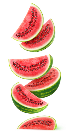 Isolated watermelon slices. Pieces of watermelon fruit flying in the air isolated on white background
