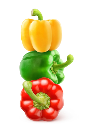 Isolated peppers. Three bell peppers of different colors (red, green, yellow) on top of each other isolated on white background 写真素材