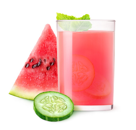 Isolated refreshment. Glass of watermelon and cucumber cocktail and pieces of fruits isolated on white background