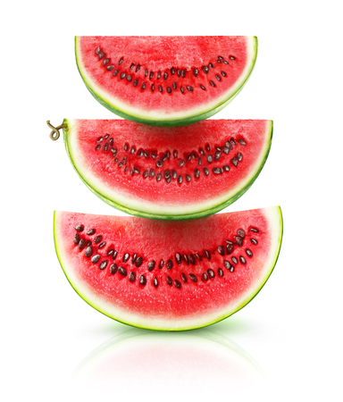 Three watermelon pieces on top of each other isolated on white background
